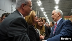 FILE - U.S. Vice President Mike Pence greets supporters following a speech about the American Health Care Act during a visit to the Harshaw-Trane Parts and Distribution Center in Louisville, Kentucky, March 11, 2017. The vice president was campaigning for the plan in Florida on March 18.