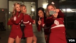 The Oklahoma Sooners' cheerleaders pause for a selfie. (G. Flakus/VOA)