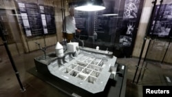 """A mockup of the bunker of German Nazi leader Adolf Hitler is pictured during a July 27, 2017, media tour in Berlin, Germany, of """"Hitler — How Could it Happen?"""" The exhibition examines how he became a Nazi and what turned ordinary Germans into murderers during the Third Reich."""