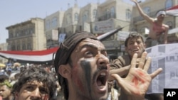 Anti-government protesters shout slogans during a rally to demand the ouster of Yemen's President Ali Abdullah Saleh outside Sanaa University, March 24, 2011