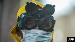 A cleaner wears protective gear to disinfect public transit as a preventive measure against the spreading of the COVID-19 coronavirus in Addis Ababa, Ethiopia, on March 20, 2020.