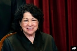FILE - Associate Justice Sonia Sotomayor sits during a group photo at the Supreme Court in Washington, April 23, 2021.