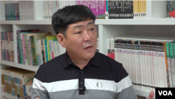 Hong Gang-chul, a former North Korean border guard who now lives in South Korea, speaks with VOA during an interview at his home office in July 2021. According to Hong, it has become much more difficult to send money to North Korea. (VOA)