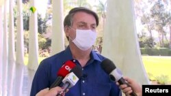 Brazil's President Jair Bolsonaro confirms positive coronavirus diagnosis as he speaks to the media in Brasilia, Brazil, July 7, 2020 in this still image taken from video.