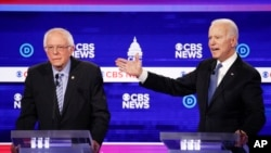 Democratic presidential candidates, Sen. Bernie Sanders, I-Vt., left, and former Vice President Joe Biden, right, participate in a Democratic presidential primary debate at the Gaillard Center, Tuesday, Feb. 25, 2020, in Charleston, S.C., co-hosted…