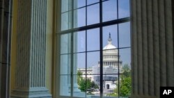 FILE - The Capitol is seen from the Cannon House Office Building rotunda, on Capitol Hill, in Washington, April 18, 2019.