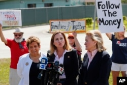 Rep. Debbie Mucarsel-Powell, D-Fla., center, speaks to members of the media about her tour of the Homestead Temporary Shelter for Unaccompanied Children, as Rep. Donna Shalala, D-Fla., left, and Rep. Sylvia Garcia, D-Texas, right, Feb. 19, 2019.