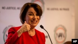 Amy Klobuchar gestures to an audience at a breakfast event on Nov. 21, 2019, in Atlanta.
