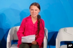 FILE - Environmental activist Greta Thunberg of Sweden addresses the Climate Action Summit in the U.N. General Assembly, at U.N. headquarters, Sept. 23, 2019.