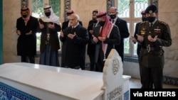 Jordan's King Abdullah II and members of the royal family including former crown prince and half-brother Prince Hamza pray at tombs of royalty in the Raghdan Palace in Amman, Jordan, Apr. 11, 2021. (Jordanian Royal Palace/Handout via Reuters)