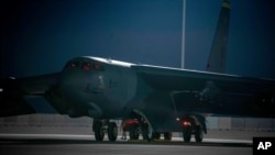 In this photo released by the U.S. Air Force, a B-52 bomber parks on the tarmac at Al-Udeid Air Base in Qatar on April 23, 2021. The U.S. Air Force has positioned two B-52 bombers in Qatar to support the American withdrawal from Afghanistan.