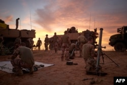 FILE - Soldiers from the French Army set up a Temporary Operative Advanced Base during the Bourgou IV operation in the area of the three borders between Mali, Burkina Faso and Niger, Nov. 9,2019.