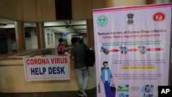 An Indian man with symptoms fills a form at a Corona virus help desk at the Government Gandhi Hospital in Hyderabad, India, Monday, March 2, 2020. Coronavirus has spread to more than 60 countries, and more than 3,000 people have died from the COVID…