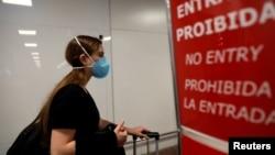 A traveler wears a face mask to protect against the coronavirus, at Salgado Filho Airport in Porto Alegre, Brazil, Feb. 27, 2020.