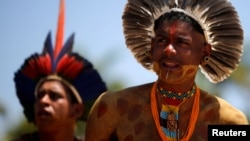 FILE - Indigenous people from ethnic groups Pataxo and Tupinamba attend a protest to defend indigenous land, outside Brazil's Supreme Federal Court in Brasilia, Brazil, Oct. 16, 2019.