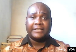 Alexander Rusero, a former journalism and international relations lecturer at Harare Polytechnic college says he is not surprised Zimbabwe's government and its supporters have condemned Hopewell Chin'ono's song. (Skype screenshot; Columbus Mavhunga)