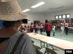 """Baltimore City's Liberty Village Project Manager Kim Trueheart looks on as her summer programs keep children active. Trueheart says """"Charm City"""" needs jobs. (VOA/C. Presutti)"""