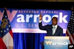 FILE - Raphael Warnock, a Democratic candidate for the U.S. Senate, speaks during a rally in Atlanta, Georgia, Nov. 3, 2020.