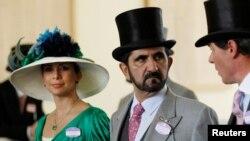 FILE - Jordanian Princess Haya bint Al-Hussein and her husband, Dubai ruler Sheikh Mohammed bin Rashid al-Maktoum, walk to the parade ring on Ladies Day, the third day of horse racing at Royal Ascot, in southern England, June 17, 2010.