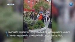 New York'ta Polis Aracını Göstericilerin Üzerine Sürdü