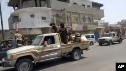 In this frame grab from video provided by Yemen Today, Yemeni army vehicles enter Zinjibar, Yemen, Aug. 28, 2019.