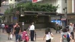 香港遊行繼續 商店地鐵提前關門