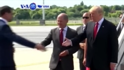 VOA60 America - President Trump meets Russian President Vladimir Putin