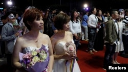 Gay and lesbian newlyweds attend a mass wedding banquet, one day after same-sex marriage officially became legal, in Taipei, Taiwan May 25, 2019. REUTERS/Tyrone Siu