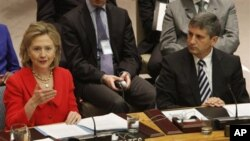 US Secretary of State Hillary Rodham Clinton addresses a UN Security Council meeting on women; Austria's Foreign Minister Michael Spindelegger is on the right, 26 October 2010