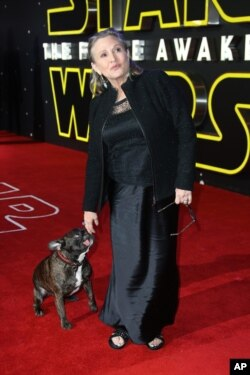 Carrie Fisher poses for photographers upon arrival at the European premiere of the film 'Star Wars: The Force Awakens ' in London, Wednesday, Dec. 16, 2015.