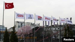 Flags of the Dogan Media Group are seen outside the Dogan Media Center in Ankara, Turkey, March 22, 2018.