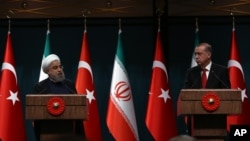 FILE - Iran's President Hassan Rouhani, left, and his Turkish counterpart Recep Tayyip Erdogan speak during a joint news conference in Ankara, Turkey, April 16, 2016. Тhe two countries are now seen as very much on different sides in the Middle East.