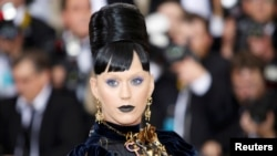 """FILE - Singer-songwriter Katy Perry arrives at the Metropolitan Museum of Art Costume Institute Gala (Met Gala) to celebrate the opening of """"Manus x Machina: Fashion in an Age of Technology"""" in the Manhattan borough of New York, May 2, 2016."""