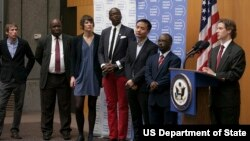 Alec Ross, Senior Advisor for Innovation in the Office of Secretary of State, speaking and presenting the Internet Freedom Fellows 2013 ( left to right ) Grigory Okhotin, Edetaen Ojo, Bronwen Robertson, Mac-Jordan Degadjor, Michael Anti, and Usamah Mohame.