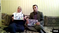 Ameneh Ghaderi, mother of detained Iranian Kurdish activist Zaniar Moradi, and Amjad Hossein Panahi, brother of detained Iranian Kurdish activist, Ramin Hossein Panahi, make a statement from Marivan, Iran, on September 7, 2018.