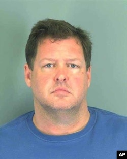 This photo made available by the Spartanburg, S.C., County Sheriff's Office shows Todd Kohlhepp of Moore, S.C. Kohlhepp was arrested Nov. 3, 2016, in connection with a woman found chained inside a storage container on a property in Woodruff, SC.