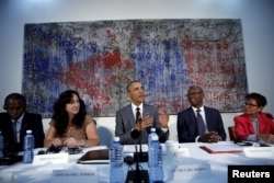 "FILE - U.S. President Barack Obama attends a meeting with Cuban dissidents at the U.S. embassy in Havana, Cuba, March 22, 2016. On the wall behind Obama is a painting, ""My New Friend,"" donated to the embassy by Michel Mirabal, a Cuban artist."