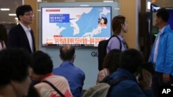 People watch a TV news program reporting North Korea's earthquake, at Seoul Railway Station in Seoul, South Korea, Saturday, Sept. 23, 2017.