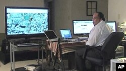 Omar Afifi Suleiman directs Egyptian demonstrations from his high tech command center near Washington, D.C.