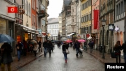 FILE - People walk along a street in the southern German town of Konstanz, Jan. 17, 2015. A shooting at a nightclub in the city left one person dead, three more injured. Police later fatally wounded the suspected gunman.