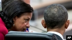 FILE - Then national security adviser Susan Rice talks with then president Barack Obama at a nuclear security summit, in Washington. April 1, 2016. President Donald Trump claims Rice illegally disclosed names of his associates who were mentioned in intel reports last year.