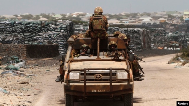 Kenya Defense Force soldiers, serving in African Union Mission in Somalia, on patrol, Kismayo, June 2013 file photo.