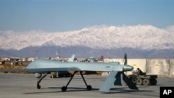 A US Predator unmanned drone armed with a missile sets off from its hangar at Bagram air base [file photo]