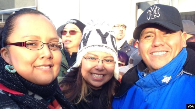 April Draper Uentillie, left, her sister Tierra Draper, center, and husband, Orlando Uentiliie, Native Americans of the Navajo Nation who live in New Mexico, traveled to New York to see their brother, Spike who is performing in the Macy's Thanksgiving Par
