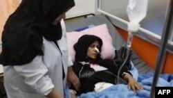 Cô Asmar Abboud, 31 tuổi, bị thương trong vụ nổ bom đang được điều trị trong bệnh viện ở Basra, ngày 15/1/2012
