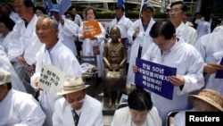 FILE - Descendants of Koreans who were conscripted to the Japanese imperial army or recruited for forced labor under Japan's colonization attend an anti-Japan rally in Seoul, South Korea, June 22, 2015. New lawsuits concerning WWII forced labor have been filed.