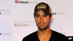 Enrique Iglesias appears during the IHeartRadio Ultimate Pool Party at the Fontainebleau Miami Beach on Saturday June 30, 2012.