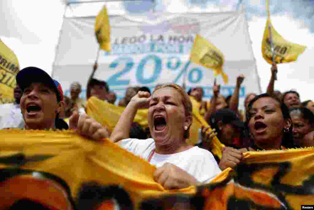 Opposition supporters shout slogans, during a gathering to demand a referendum to remove President Nicolas Maduro, in Caracas, Venezuela.