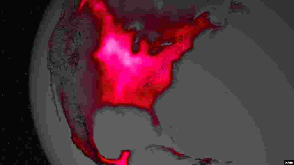 The magnitude of fluorescence portrayed in this visualization prompted researchers to take a closer look at the productivity of the U.S. Corn Belt. The glow represents fluorescence measured from land plants in early July, over a period from 2007 to 2011. (Image Credit: NASA's Goddard Space Flight Center)