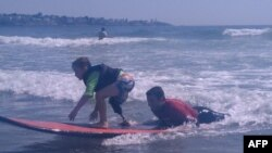 Disabled Surfers Ride the Waves